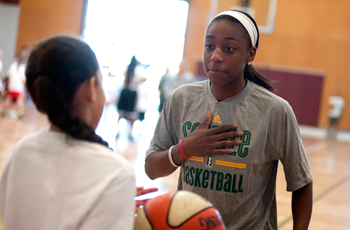 Jewell Loyd talking to a child