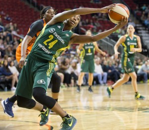 Jewell Loyd stretches to pull in the offensive rebound. (Neil Enns/Storm Photos)