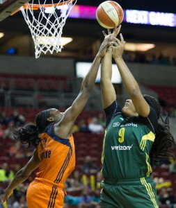 Markeisha Gatling isn't fouled by the Sun's Chiney Ogwumike. Gatling finished with just two points, but pulled in three rebounds and a steal. (Neil Enns/Storm Photos)