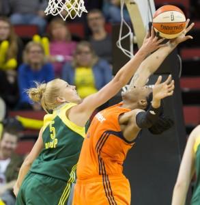Abby Bishop applies tough defense against the Sun's Kelsey Bone. (Neil Enns/Storm Photos)