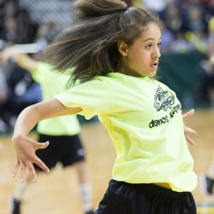 Dance Troupe member Ari performs during a break in the action. (Neil Enns/Storm Photos)