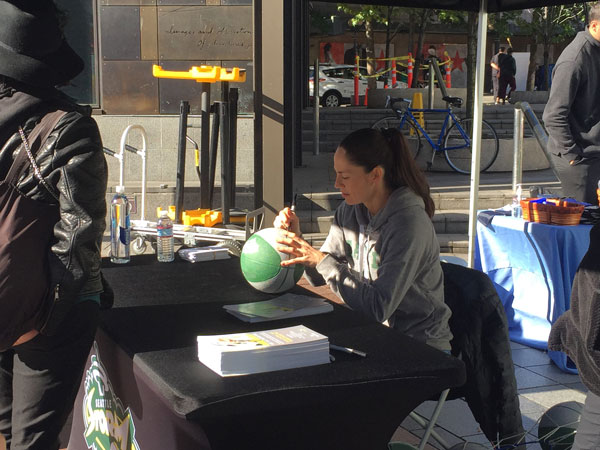 Sue Bird autographing balls